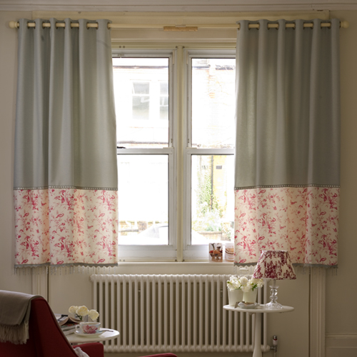 Mix panels of plain and pictorial fabric for a window that's a real work of art