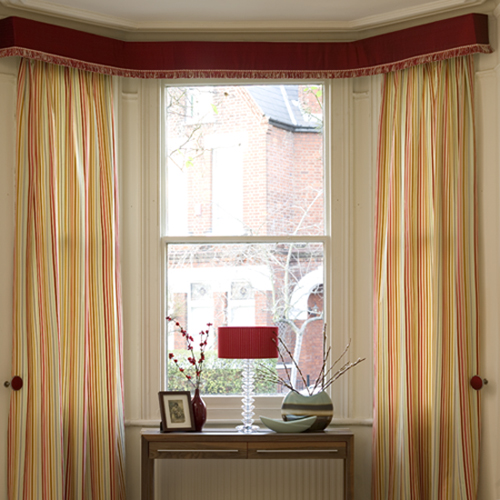 A neat, modern pelmet creates a smart, fuss-free finish in a large bay window