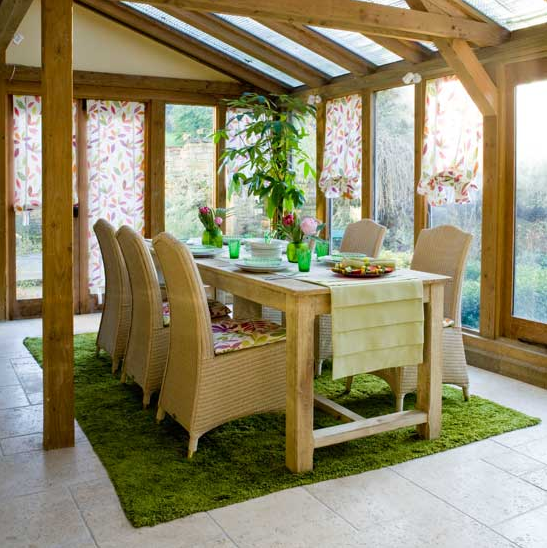 The perfect indoor-outdoor space, complete with a grassy rug