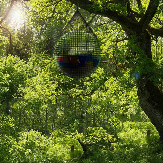 Hanging around: A specially-designed net allows the Cocoon 1 to be hung from trees although we're not quite sure how you'd get in or out \ Micasa Lab, REX Features
