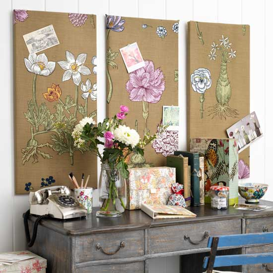 Hang two or three covered boards on the wall behind your desk or table.